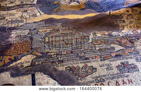 MADABA, JORDAN - NOVEMBER 25, 2016 Ancient 6th Century Map Jerusalem Mosaic Saint George Greek Orthodox Church Madaba Jordan. Mosaic discovered 1884 and depicts the Holy Land including Jerusalem Jordan River and Dead Sea in 6th Century AD. Map was used to