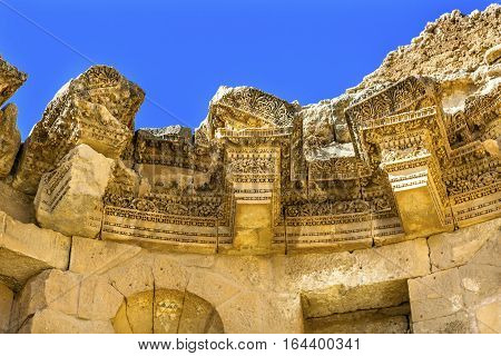 Decorations Nymphaeum Public Fountain Ancient Roman City Jerash Jordan. Jerash came to power 300 BC to 100 AD and was a city through 600 AD. Not conquered until 1112 AD by Crusaders. Famous Trading Center. Most original Roman City in the Middle East.
