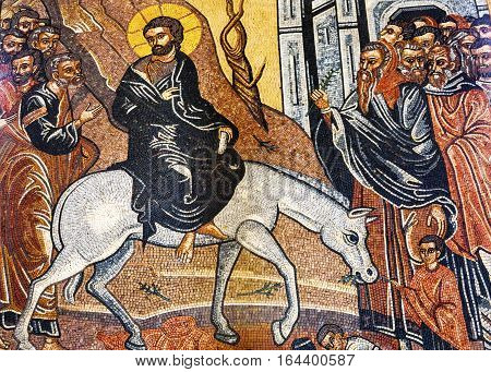 MADABA, JORDAN - NOVEMBER 25, 2016 Jesus Christ Palm Sunday Donkey Mosaic Saint George Greek Orthodox Church Madaba Jordan. Church was created in the late 1800s and houses many famous mosaics