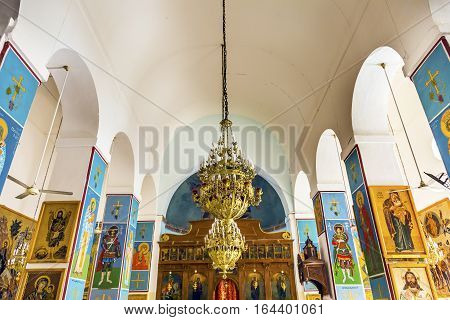 MADABA, JORDAN - NOVEMBER 25, 2016 Golden Icons Frescoes Altar Chandelier Saint George's Greek Orthodox Church Madaba Jordan. Church was created in the late 1800s and houses many famous mosaics