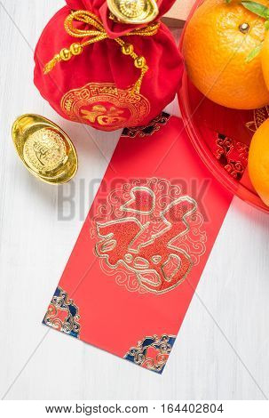 Chinese New Year,red Envelope Packet (ang Pow) And Red Felt Fabric Bag With Gold Ingots And Oranges
