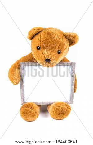 Brown Fuzzy Teddy Bear Holding A Grey Frame Isolated On A White Background