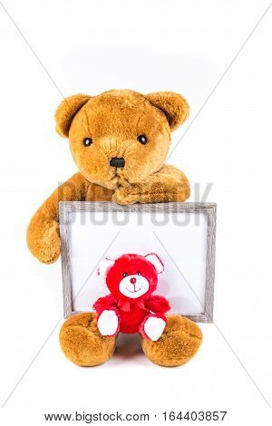 Brown And Red Fuzzy Teddy Bears With A Grey Frame Isolated On A White Background