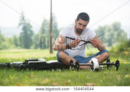 Man Tightening Propeller On Drone In Nature