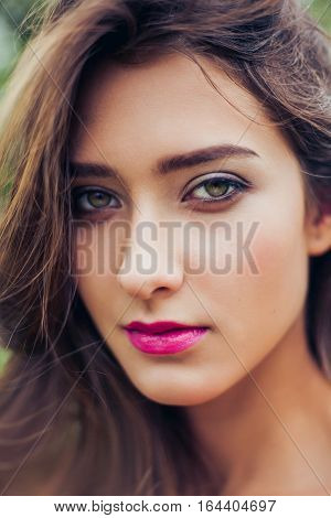 Magnificent portrait of a beautiful young woman with perfect skin closeup. Outdoors portrait