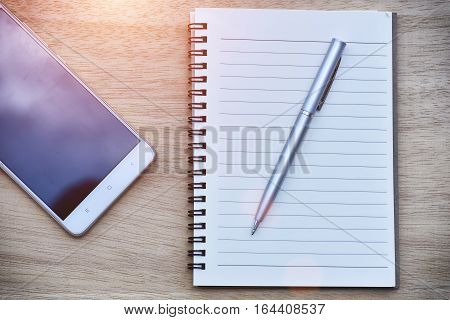 Purple Notebook with pencil and glasses on desk work
