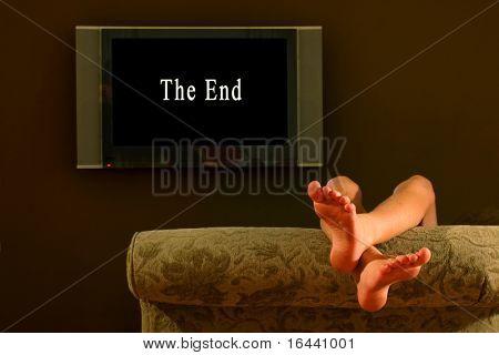 reclining child watching tv