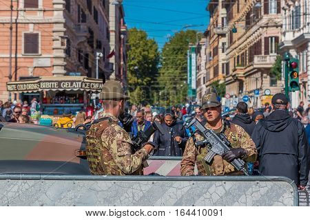Italian Alpini Soldiers With Weapons Guarding The Streets In Rome