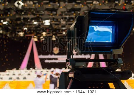 Recording at television studio Camcorder at conference,Black background