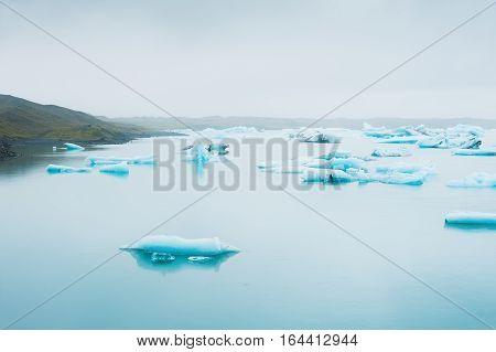 Blue Icebergs In Jokulsarlon Glacial Lagoon, South Iceland