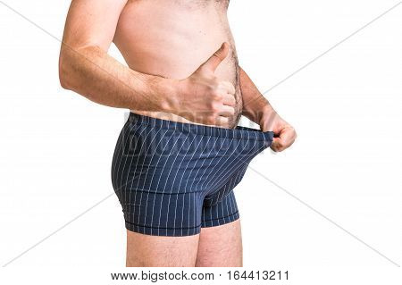 Man Is Looking In His Underwear And Pointing Thumb Up