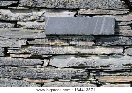 Schist stones on a house piled to a wall