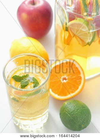 Cold fresh lemonade drink. Refreshing summer sangria. Homemade punch with fresh fruits and mint leaves.