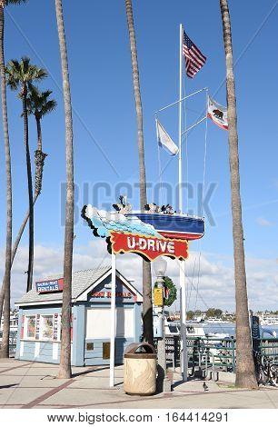 NEWPORT BEACH CALIFORNIA - JANUARY 6 2017: U-Drive Boat Sign. The boat rental facility in on the Balboa Peninsula in the Fun Zone area.