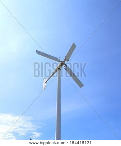 wind turbines in daytime on blue sky background