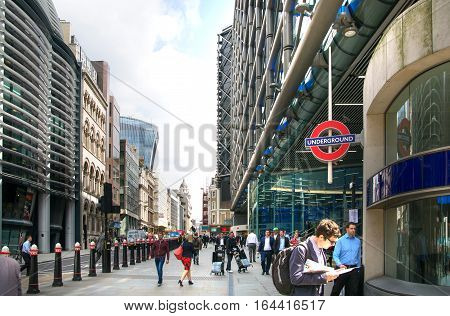 LONDON, UK - 17 may, 2016: City of London. Cannon street and tube station. Road with transport, red double-decker buses and walking people.