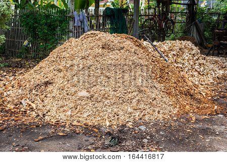 Large Pile of Wood Flakes on Ground
