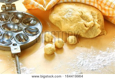 preparation homemade cookies dough balls towel and iron baking dish on table