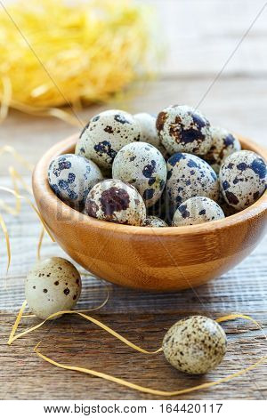 Motley Quail Eggs In A Wooden Bowl.