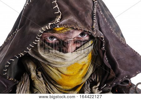 Nuclear post apocalypse life after doomsday concept. Scary closed face of grimy survivor in tatters. Studio closeup portrait white background