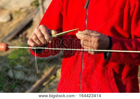 Fisherman Knits Fishing Nets - Selective Focus, Copy Space