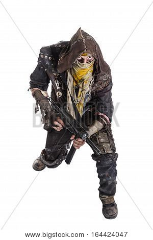 Nuclear post apocalypse life after doomsday concept. Grimy survivor with homemade weapons. Studio high angle portrait on white background