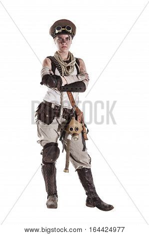 Nuclear post apocalypse life after doomsday concept. Grimy female survivor in tatters. Studio portrait on white background