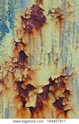 Flaking old and cracked paint from rusty iron - design flaw