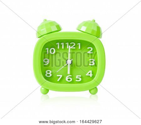 Green alarm clock isolated on white background Saved clipping path.
