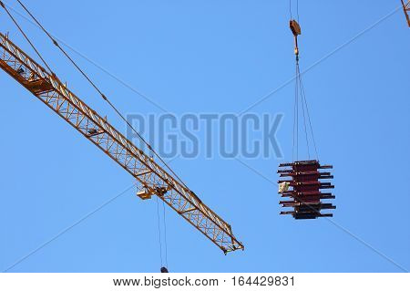Machinery Crane Hoisting Up Steel Rod Bar In Construction Site
