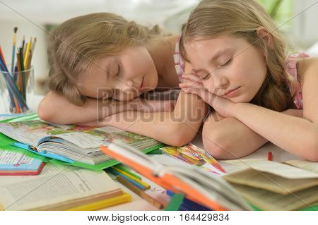 two sisters twins fall asleep while doing homework