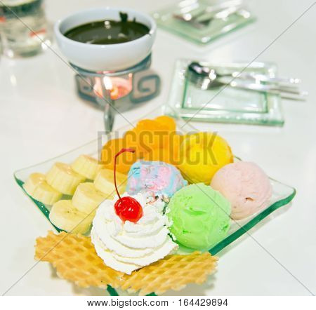 Ice-cream With Berry, Whip Cream Served With Banana, Waffle And Chocolate Fongdu