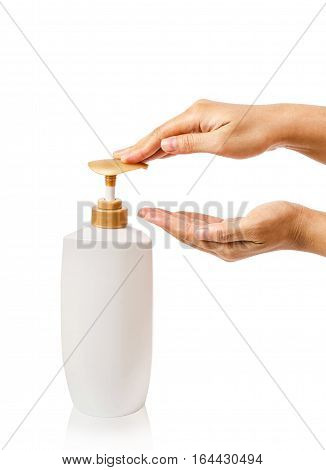 Female hands pushing pump bottle isolated on white background. Saved clipping path.