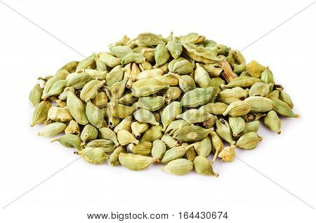 Heap of green cardamon isolated on white background.