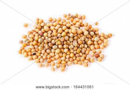Heap of mustard seeds isolated on white background.