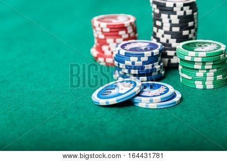 a poker chips on a green table