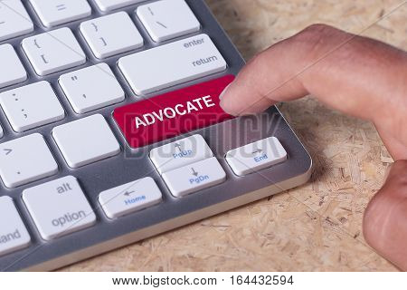 Man pressed keyboard button with advocate word