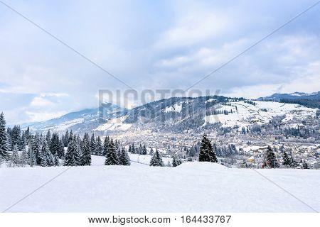 Beautiful mountains view with fog at resort town vatra dornei, bucovina, suceava, romania