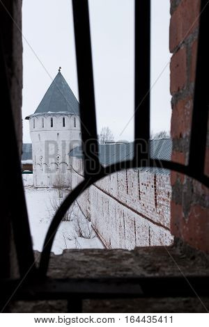 Spaso-Priluckiy monastery in winter. View a gallery of monastery wall. Vologda tower. Vologda. Travel north Russia. Ancient architecture. Saviour Priluki Monastery in winter frosty day
