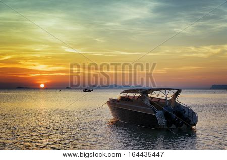 Motorboat At Sunset. Beautiful Landscape