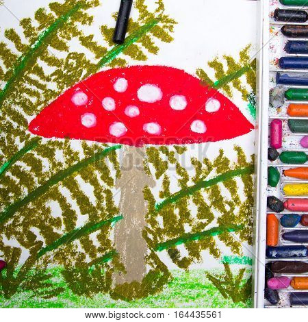 Colorful drawing: Red toadstool in the grass