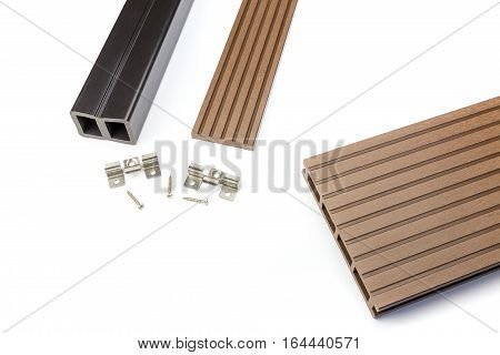Brown composite decking plank with fastening material