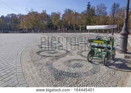 Surrey bike ready for rent and fun. Plaza de Espana Seville Spain
