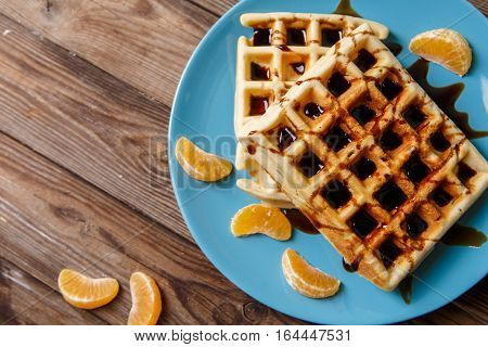 Photo of Viennese waffles on blue plate