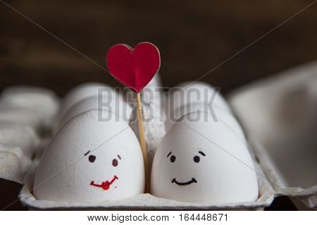 Love eggs couple with hearts in the box