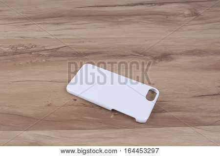 Case For Smart Phone On Wood Background