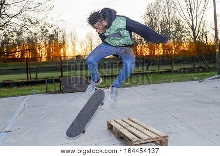 Young Skateboarder Jumping On A Ramp Outdoor