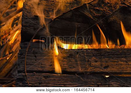 Close-up of wooden board engulfed in flames