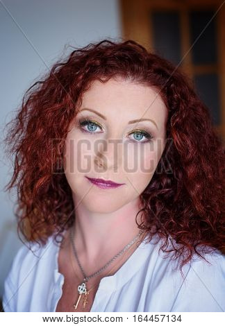 Portrait of the beautiful red haired girl