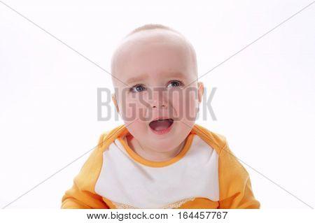 photo of crying baby on white background